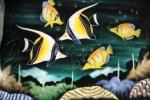 Dua ekor  Moorish Idol  Fish yang bermain bersama dengan kawanan Regal Angel Fish