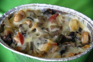 Champignon Cheese On Potatoes.